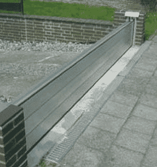 Barrier-system-at-the-property-line-flood-resilience-construction